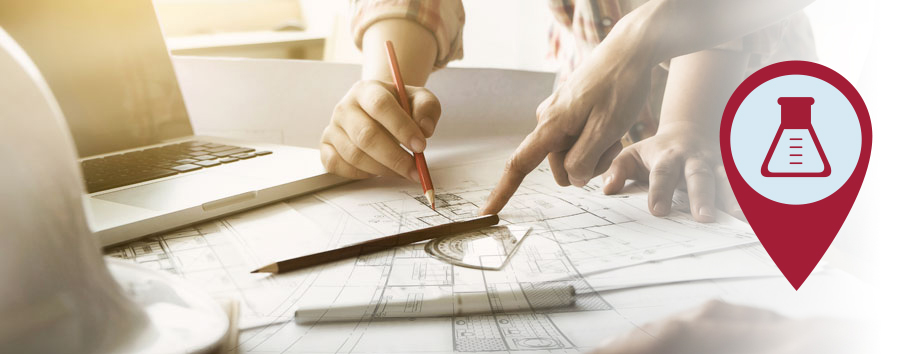 Photo of a people working on blueprints
