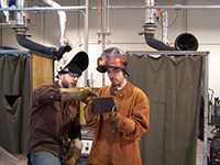 Image of two welders