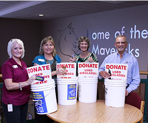 Lions Club donation for eyeglasses and cellphone bins