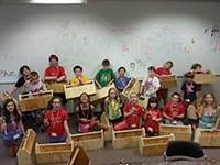 Youth camp woodworking group of students