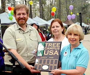 LSC-Montgomery receives Tree Campus USA recognition from John Warner, district urban forester with Texas A&M Forest Service during last month's Texas Wildlife & Woodland Expo event. Also pictured are (center) Linda Corbin, director of facilities at LSC-Montgomery, and Pat Sendelbach, interim vice president of administrative services at LSC-Montgomery.