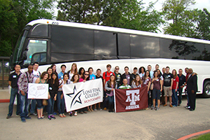 transfer students in front of the bus
