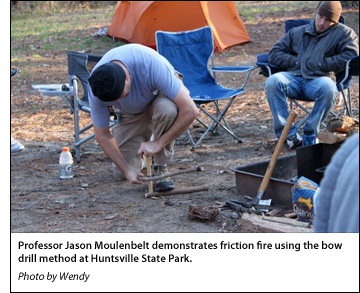 Professor Jason Moulenbelt demonstrates friction fire using the bow drill method at Huntsville State Park