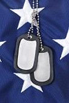 picture of dogtags on the american flag