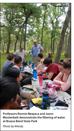 Professors Ronnie Nespeca and Jason Moulenbelt demonstrate the filtering of water at Brazos Bend State Park