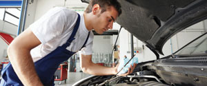 Image of man working on car