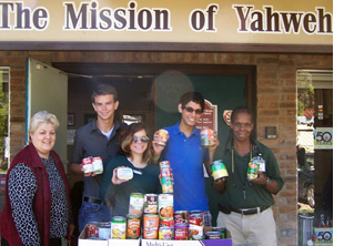 Performance Troupe donates canned goods to Mission of Yahweh