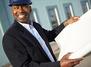 african american man in a hardhat and business suit