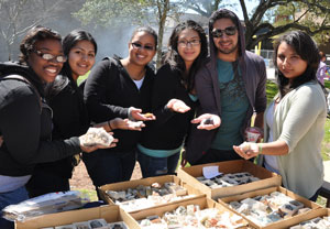 Geology students holding rocks
