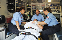 EMS photo of three students in an ambulance