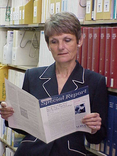 Dr. Cher Brock reads an educational special report.