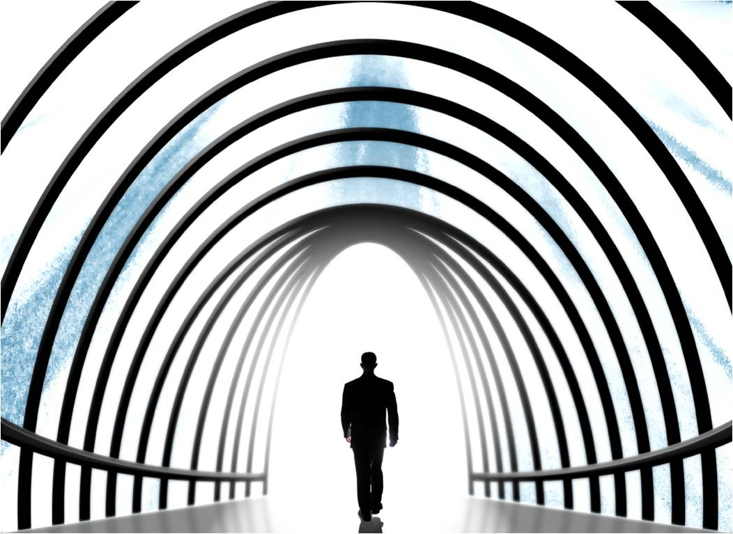 Man walking into tunnel