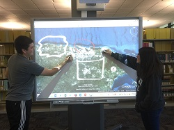 photo of students using the SmartBoard