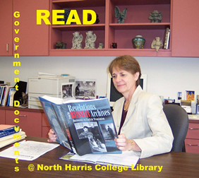 Maryann Readal, former NHC Library Director, reading to her gargoyles about revelations in the Russian Archives.
