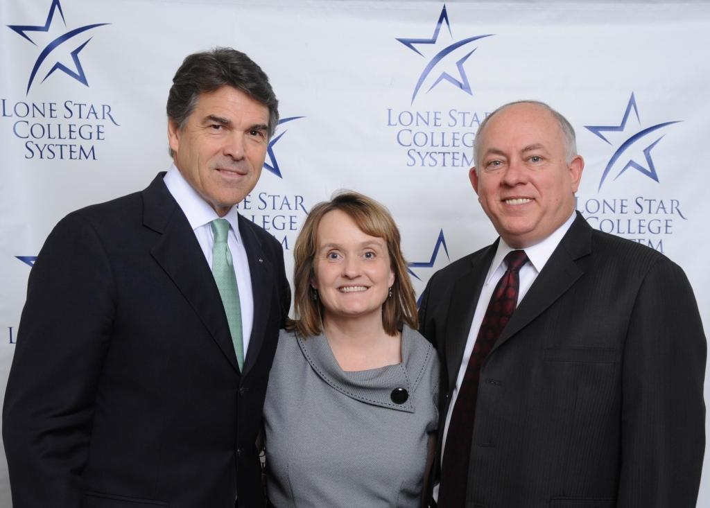 Texas Gov. Rick Perry, left, is pictured at the North Houston Economic Symposium on Feb. 11 with Chancellor Dr. Richard and Dana Carpenter.