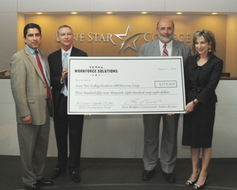 Pictured at the Skills Development Fund grants check-signing presentation on March 11 at Lone Star Corporate College are, left to right, Andres Alcantar, TWC commissioner; Rand Key, LSCS senior vice chancellor, COO; Larry Temple, TWC executive director; and Linda Head, LSCS associate vice chancellor.