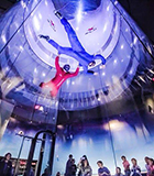 two people indoor skydiving