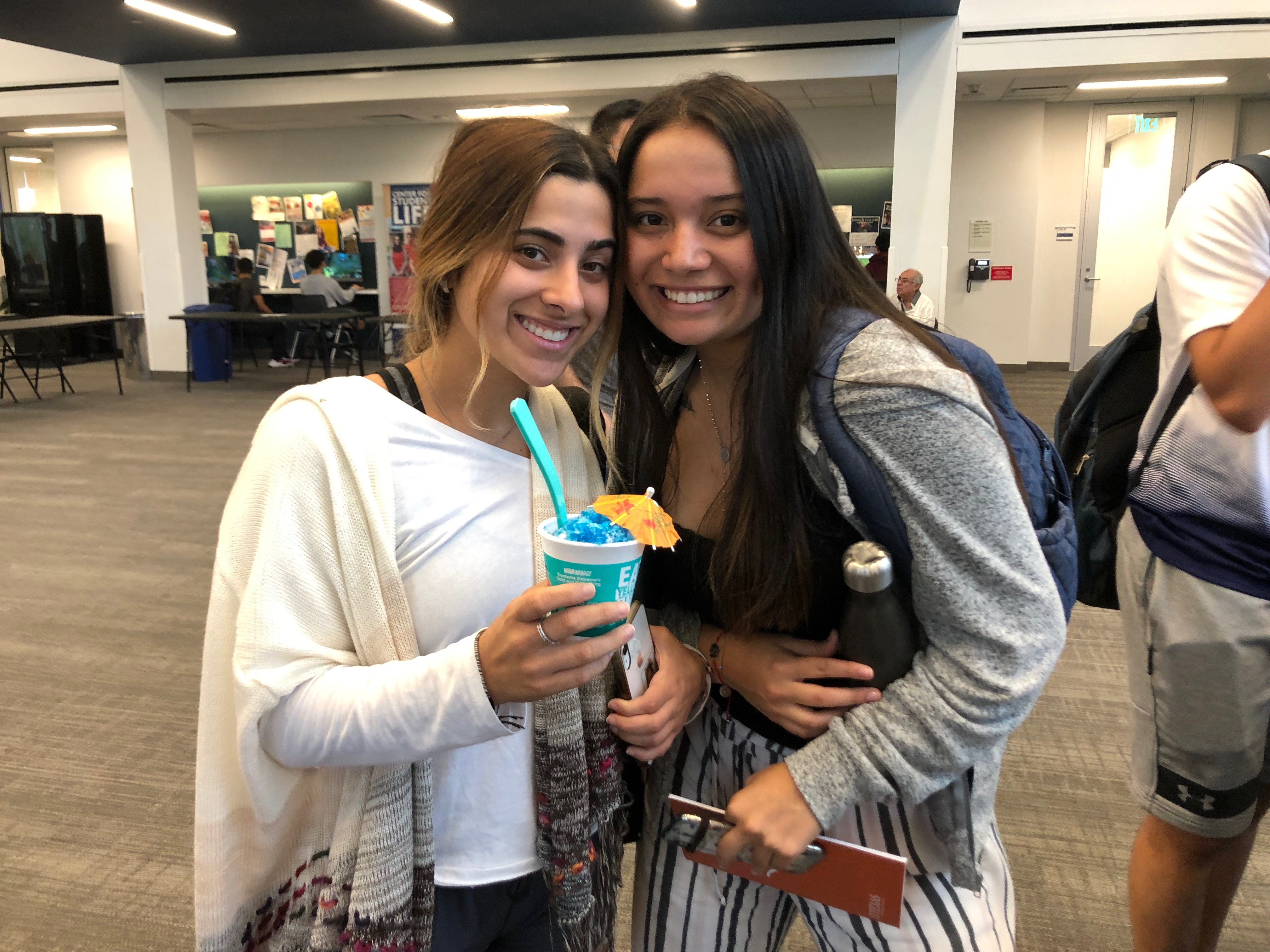 Two students with Bahama Bucks at Transfer Fair