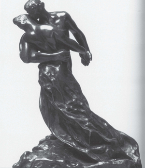 ebony statue of man and woman in arms