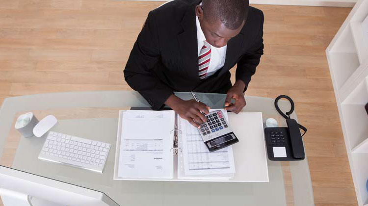 photo of man working in accounting