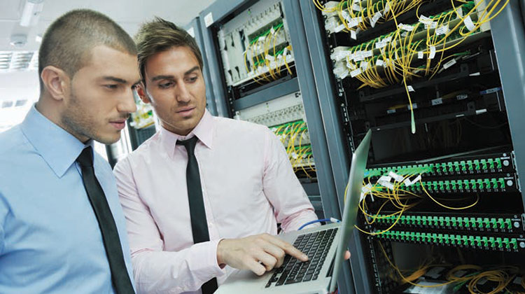 Two IT people in a server room