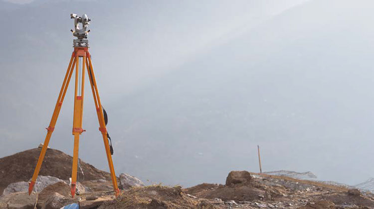 Land surveying equipment on a tripod.