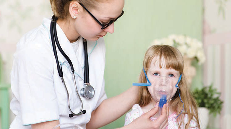 Young girl receiving a breathing treatment