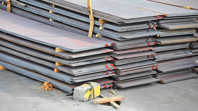 Stacks of sheet metal in rows