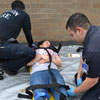 LSC students practice their training on a patient with realistic-looking injuries.