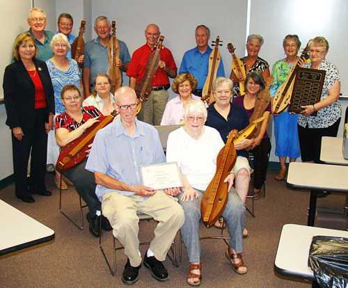 Holding her dulcimer, Nancy Price (pictured front right), Lone Star College-Montgomery�s Academy for Lifelong Learning�s Instructor of the Year, is surrounded by current and former dulcimer students.