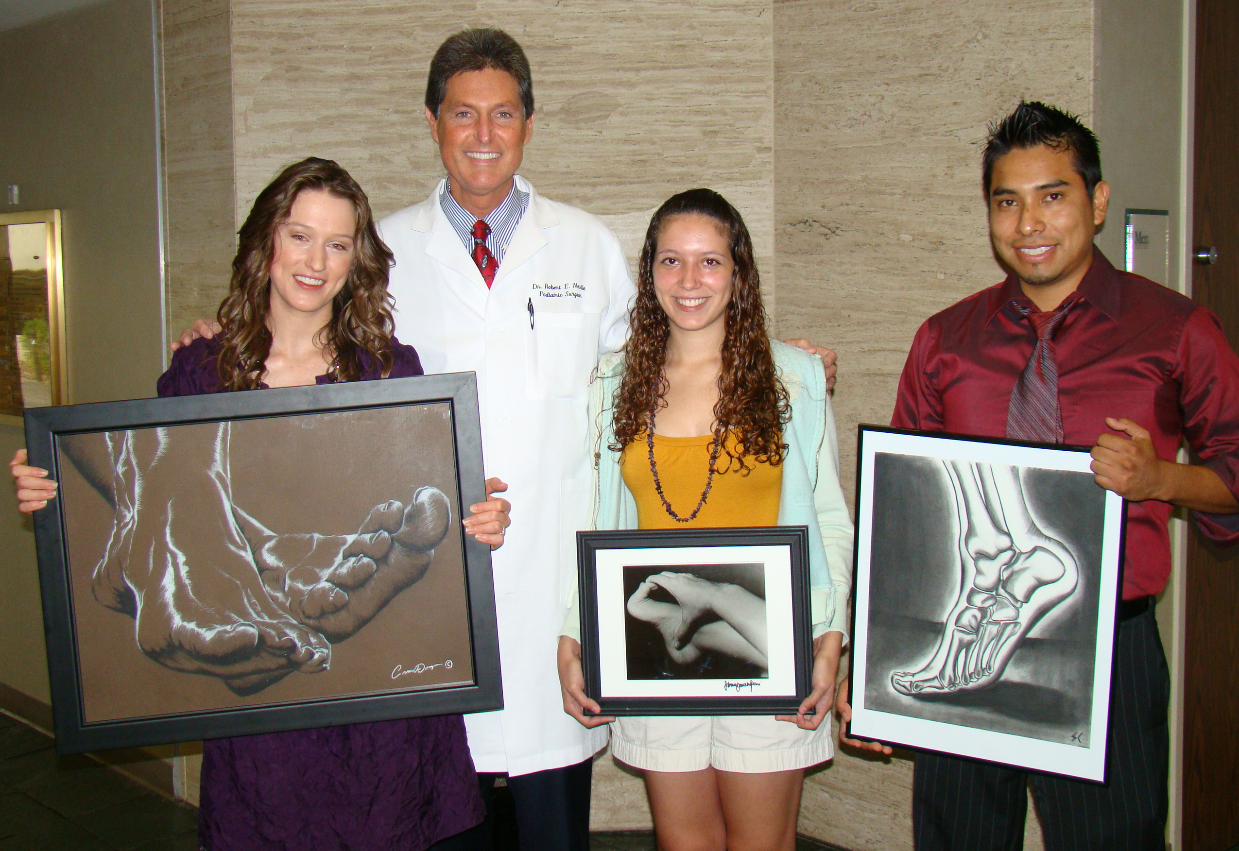 Dr. Robert Neville, of Foot Health Care Center in The Woodlands, proudly recognizes three of the four winners of his annual foot art scholarship contest. Pictured from left to right are: Cassandra van Dongen, Dr. Neville, Sabrina Camacho Pessi, and Steeve Calderon.