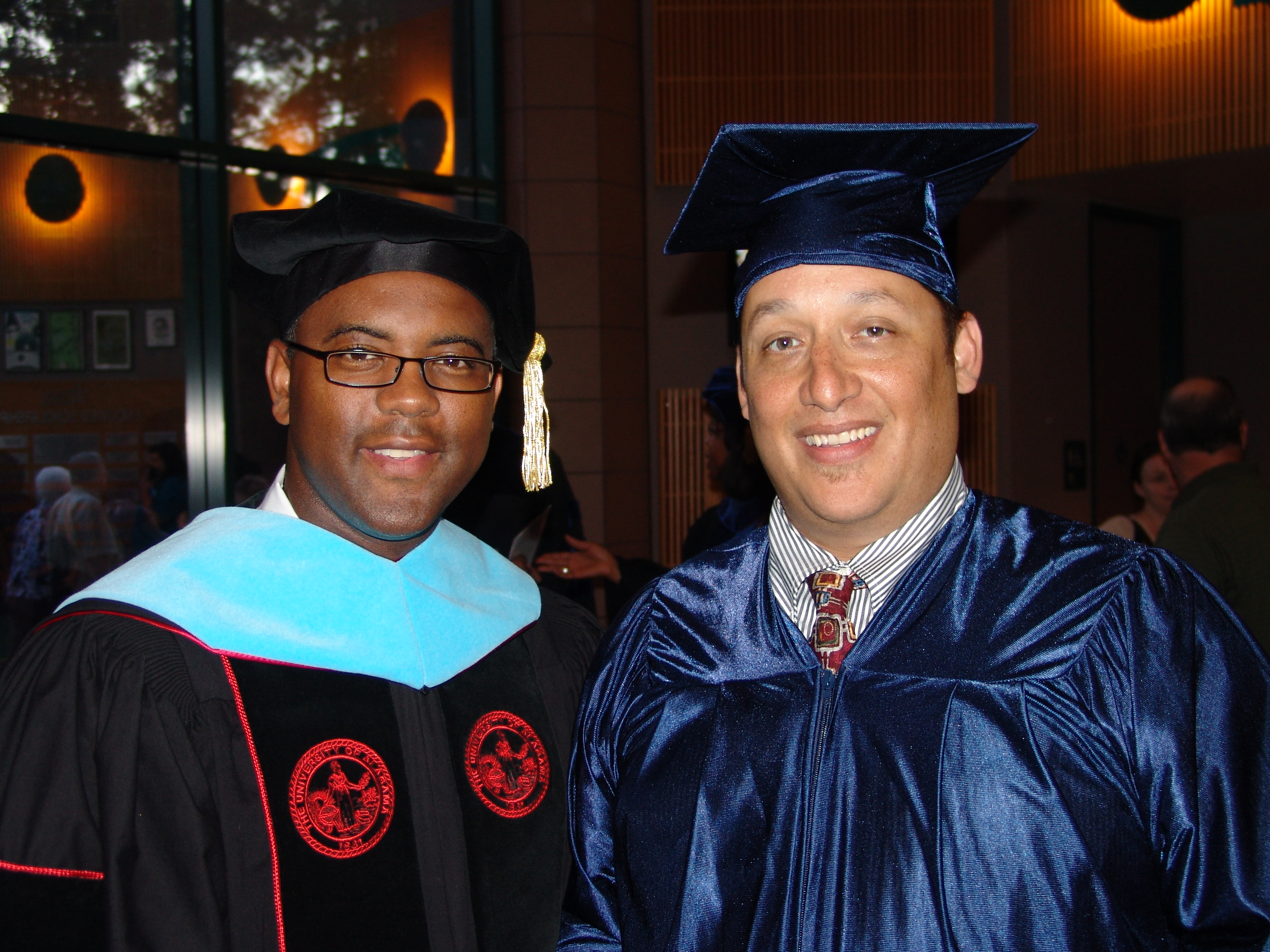 Dr. Austin Lane (left) congratulates Dominic Vessell, who recently completed the General Educational Development (GED) program through Lone Star College-Montgomery. Vessell also served as the student speaker during the GED Commencement ceremony.