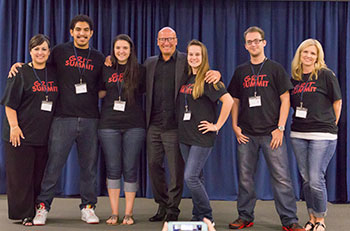 Lone Star College-Tomball president Dr. Lee Ann Nutt (far left) and Dr. Paul G. Stoltz (center) pose with LSC-Tomball students at last year's GRIT Summit. The second annual event will be held at LSC-Tomball on October 13.