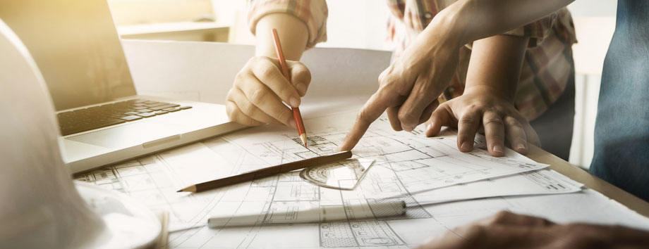 Pencil and protractor on top of plans