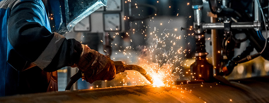 Welder working on a pipe.
