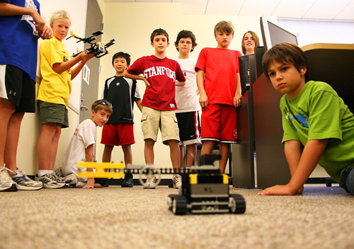 "A group of ""future engineers"" test out some of their very own LEGO robotic creations during Discovery College, a fun and exciting summer enrichment program for youth at Lone Star College-Montgomery."