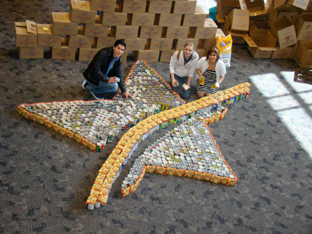 "Pictured placing the cans into the Lone Star College ""Star of Tomorrow"" logo design are students (l. to r.): Julio Maldonado, The Woodlands; Anna Mayfield, Conroe; and Angela Ghazi, Magnolia."
