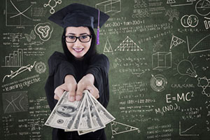 College graduate holding money