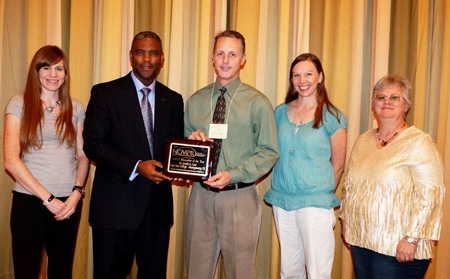 Dr. Austin A. Lane, president of LSC-Montgomery, was recently recognized for his leadership in college marketing and public relations efforts. Pictured with Dr. Lane are member of LSC-Montgomery�s college relations department. (From left to right are Lauren Maddox, writer; Lane; Steve Scheffler, dean of college relations; Brandy Ugent, program coordinator for web content and design; and LaNae Ridgwell, manager of marketing and publications.)