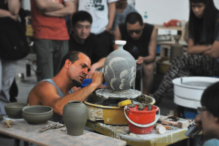 Robby Wood, ceramics professor at Lone Star College-Montgomery, recently conducted a pottery demonstration for members of The Pottery Workshop, an international ceramics center located in Jingdezhen, China.