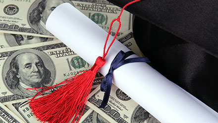 Photo of graduation cap with money