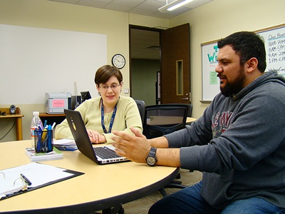 Brandi Ford-Griffin, a Writing Consultant, Working with a Student