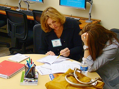 Kim Stelter, a Writing Consultant, Working with a Student