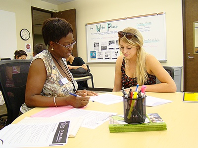 Martina Kusi-Mensah, the Writing Center Director, Working with a Student