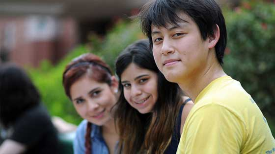 Group of three students on campus
